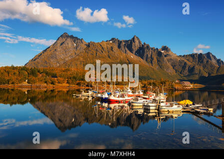 Fishing boats and yachts on Lofoten islands in Norway - Stock Photo