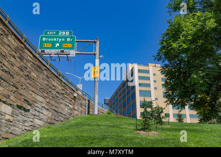 Green Brooklyn Bridge Exit only sign in Brooklyn at the end of The Brooklyn Bridge , New York City - Stock Photo