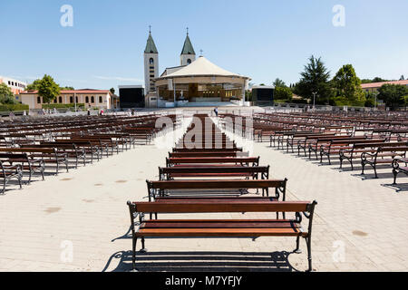 Medjugorje, Bosnia and Herzegowina, July 15 2017: Saint James Church with wooden benches in Medjugorje is a popular - Stock Photo