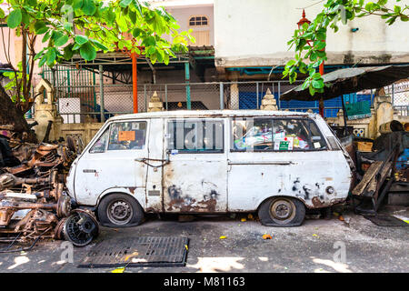 BANGKOK, THAILAND - APRIL 24: Rusty van on the street of Bangkok on April 24, 2016 in Bangkok, Thailand. - Stock Photo