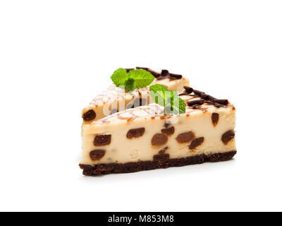 Baked  white and dark chocolate cheese cake isolated on white - Stock Photo