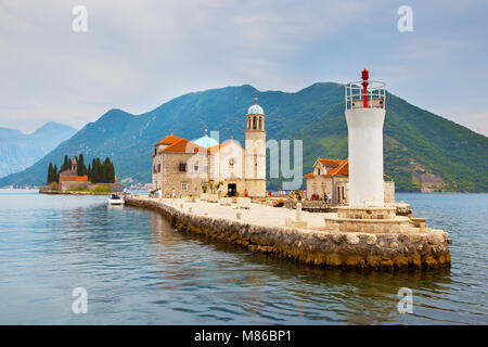 Our Lady of the Rocks church and lighthouse on small island in the Kotor Bay near Perast town, Montenegro - Stock Photo