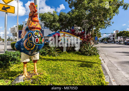 Large and colourful rooster sculpture on the roadside, Calle Ocho, Little Havana, Miami, Florida, USA. - Stock Photo