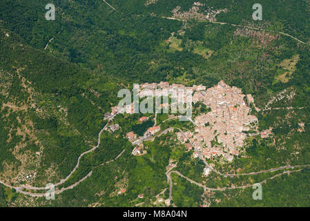 Aerial image of the village of Patrica surrounded by forests in the Lazio region of Italy, Province of Frosinone - Stock Photo