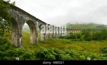 High resolution panorama of Glenfinnan railway viaduct (location from Harry Potter movie) shot from side, on overcast - Stock Photo