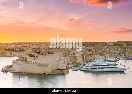 Sunrise over Birgu and Grand Harbor in Malta. - Stock Photo