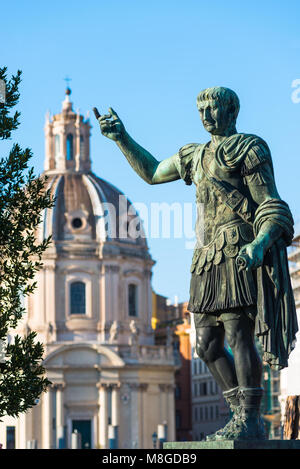 Emperor Trajan statue at Trajan's Market and Forum in the city of Rome, Italy, located on the Via dei Fori Imperiali, - Stock Photo