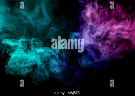 Dense multicolored smoke of pink and   blue  colors on a black isolated background. Background of smoke vape - Stock Photo
