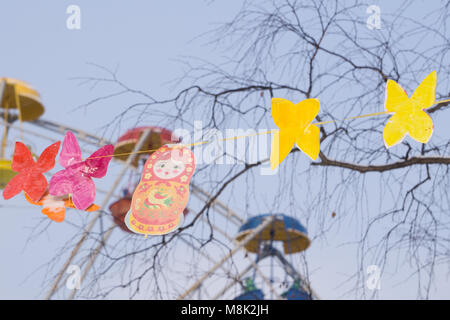 Decorative sparkly snowflakes and paper candies on white isolated background. Holiday new year garland top View - Stock Photo