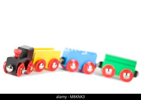 Toy wooden train with carriages on white background - Stock Photo