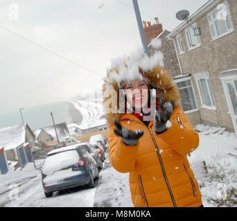 Portland, Dorset. 18th March 2018 - Sophie, 22, sees snow for only the second time in her life on the Isle of Portland - Stock Photo