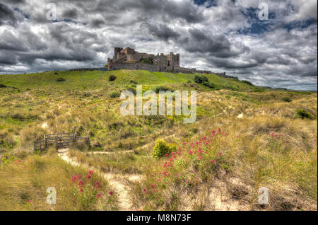 Bamburgh Castle Northumberland northern England medieval fortress on hill in hdr - Stock Photo