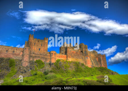 English medieval castle Bamburg Northumberland on hill in bright colourful hdr - Stock Photo