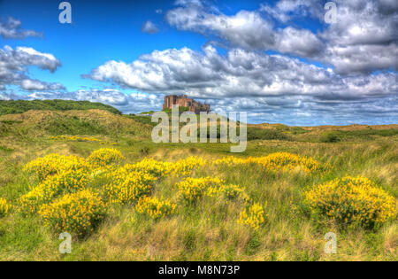 Bamburgh Castle Northumberland north east England medieval fort on hill in hdr - Stock Photo