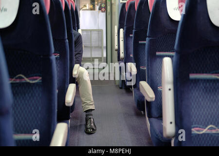 An anonymous man on a train. - Stock Photo