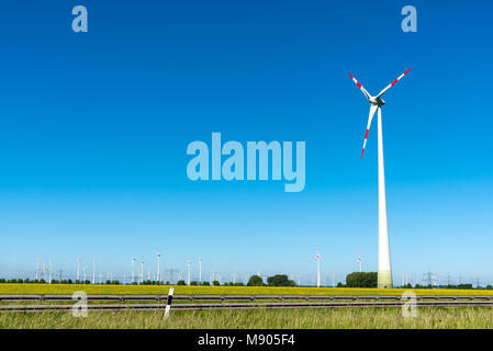 Renewable energy plants with a blue sky seen in Germany - Stock Photo