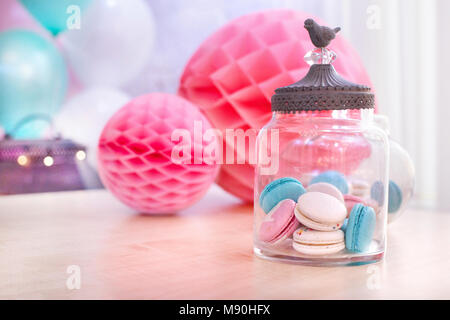 Colorful macaroons and paper balls - Stock Photo