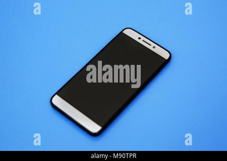 Black smartphone mockups. Can use for printing, website, presentation element. for app demo on phone. Empty screen . Black smartphone in blue backgrou - Stock Photo