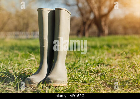 Close up of rubber boots in the garden - Stock Photo