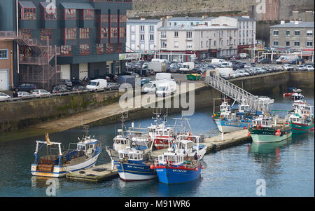 The Wooden Fishing Boats of the Brittany Inshore Fishing Fleet moored up alongside Brest Harbour at the Fishing Quay. - Stock Photo