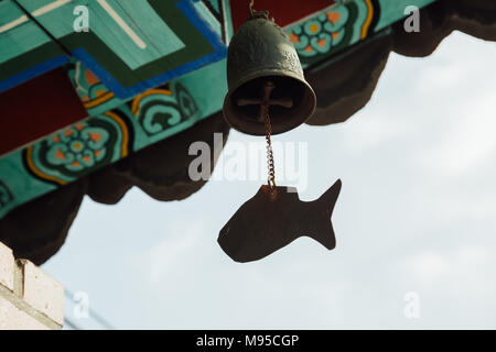 Wind chime hanging under the eaves of korean temple - Stock Photo