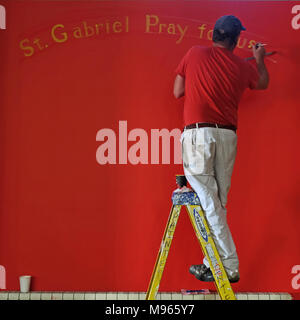Sign painter, Holy Cross Church, Ardoyne, Belfast - Stock Photo