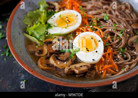 Japanese miso ramen noodles with eggs, carrot and mushrooms. Soup delicious food. - Stock Photo