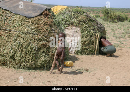 Young Hamer Tribe boy standing by his hut. Photographed in Omo River Valley, Ethiopia, Africa - Stock Photo