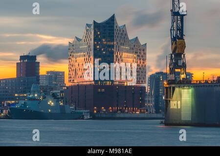 Germany, Hamburg, Hafencity, Elbe Philharmonic Hall at sunrise - Stock Photo