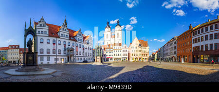 Germany, Lutherstadt Wittenberg, view to town hall, row of houses and St Mary's Church - Stock Photo