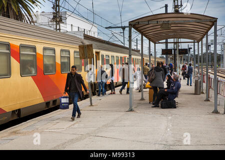 Morocco, transport, Kenitra, passengers boarding ONCF Train, second Class compartment carriage - Stock Photo