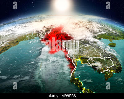 Sunrise above Myanmar highlighted in red on model of planet Earth in space with visible country borders. 3D illustration. Elements of this image furni - Stock Photo