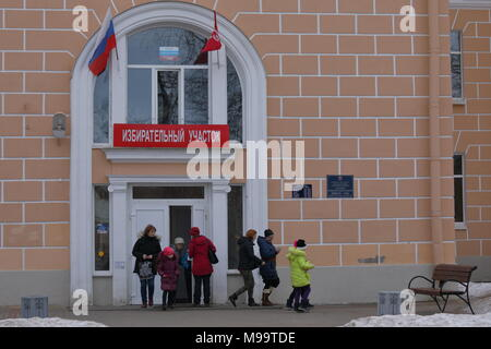 Peterhof, Saint-Petersburg, Russia - March 18, 2018: People at the polling station during Russian Presidential elections. Vladimir Putin leading with  - Stock Photo
