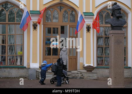 Strelna, Saint-Petersburg, Russia - March 18, 2018: People at the polling station during Russian Presidential elections. Vladimir Putin leading with a - Stock Photo