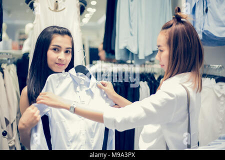 Two smiling young woman Asian with shopping and buy at mall/supermarket/market - Stock Photo