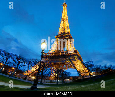 PARIS, France - MARCH 14, 2018 : the Eiffel Tower on March 14, 2018 in Paris. Illuminated Eiffel tower is the most popular travel place and global cul - Stock Photo