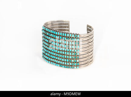 Native American Sterling Silver and Turquoise Cuff Bracelet Isolated on White. - Stock Photo
