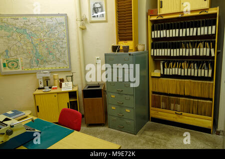 Leipzig, Germany - June 12, 2015. Stasi museum presents an office interior of the senior officials, including the table, the file cabinets, the map of - Stock Photo