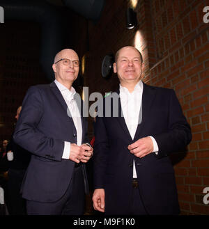 24 March 2018, Germany, Hamburg: Finance Minister Olaf Scholz (r) of the Social Democratic Party (SPD) and Peter Tschentscher (SPD), new mayor of Hamburg, arrive at a special regional meeting of his party. Photo: Daniel Reinhardt/dpa - Stock Photo