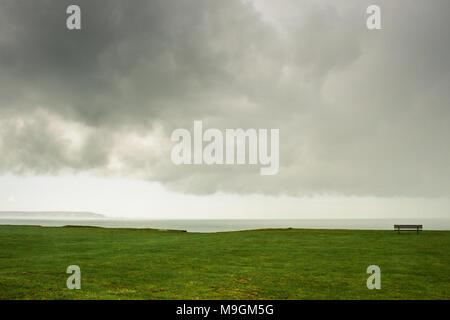 Clifftop view towards a rain storm, near Highcliffe Castle, Christchurch, Doreset, UK - Stock Photo