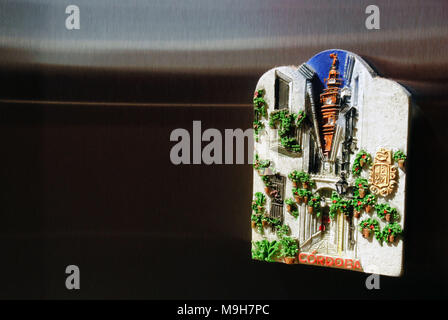 The Great Mosque seen from Calleja de las Flores, illustrated on a frdge magnet, in Córdoba, Spain. - Stock Photo