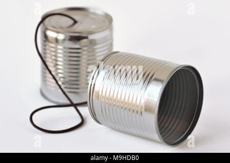 Tin cans phone on white background - Communication concept - Stock Photo