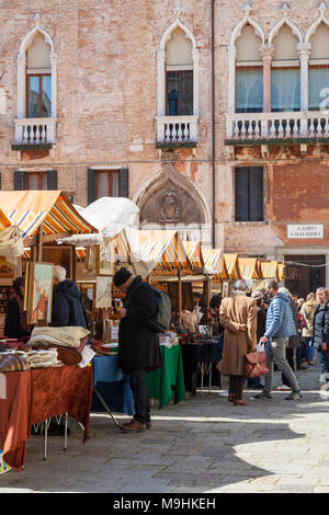 The antiques fair in Campo San Maurizio, San Marco, Venice, Veneto, Italy. This antique market, held five times a year , is popular with both locals a - Stock Photo