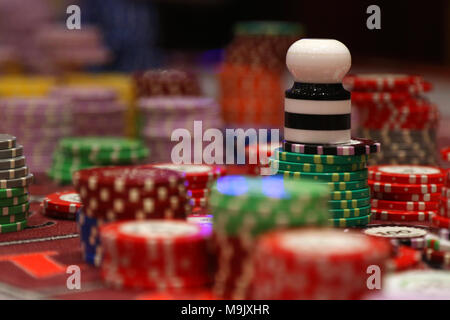 Placed chips on gambling table in casino - Stock Photo