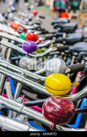 Bicycles parked in a neat row, Amsterdam, North Holland, Netherlands. - Stock Photo