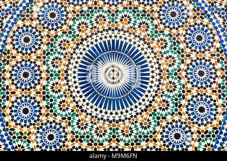 Morocco, Meknes, Place el-Hedim, colourful zellij patterned tilework decorating water fountain - Stock Photo