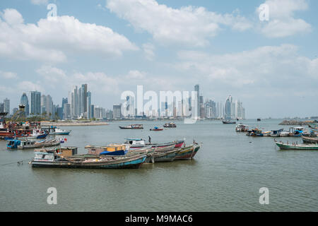 Boats near fish market and skyscraper skyline, coast of Panama City, Panama - Stock Photo