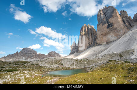 Northern walls of the Three Peaks of Lavaredo with lake near Col Forcellina, Sexten Dolomites, South Tyrol, Trentino-South Tyrol - Stock Photo
