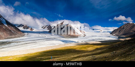 View of snow-covered Altai mountains with clouds and blue sky, Mongolia - Stock Photo