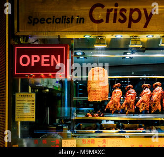 Shop window of a restaurant in Chinatown, London, Great Britain - Stock Photo